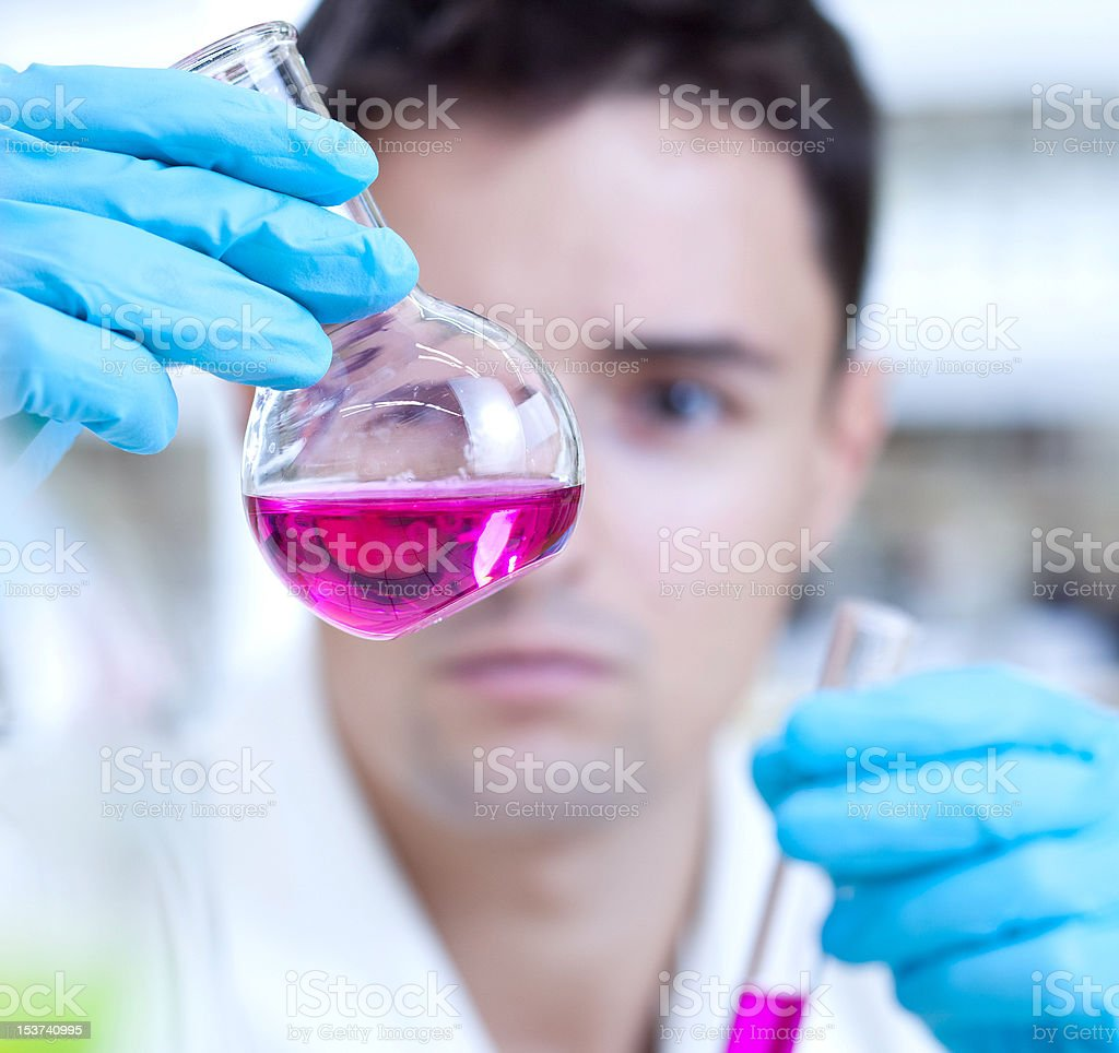 young male researcher in a chemistry lab royalty-free stock photo