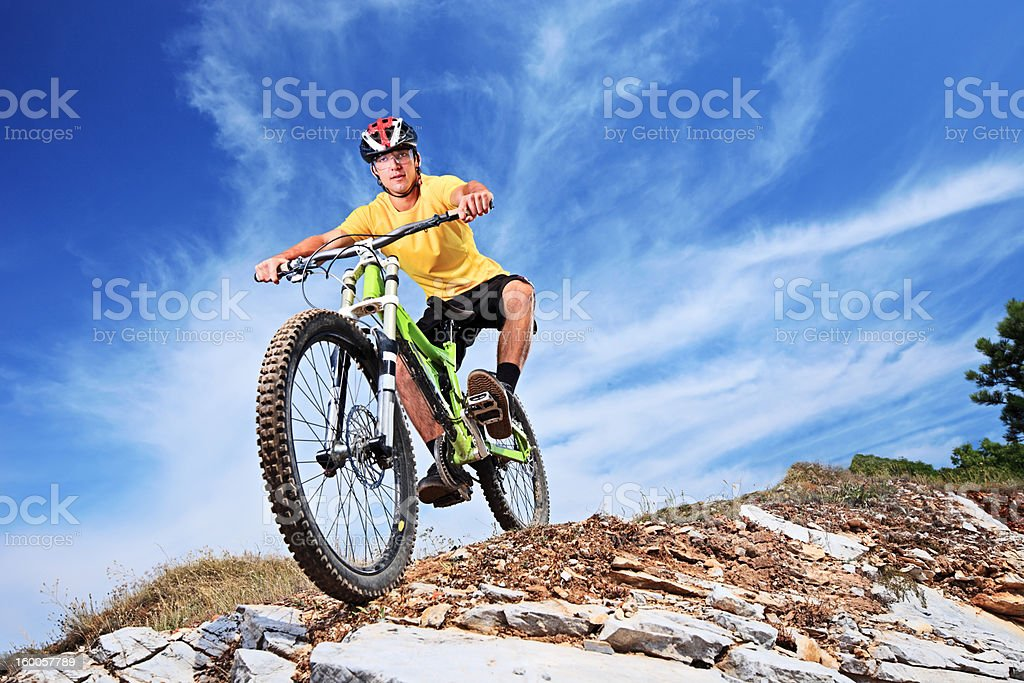 Young male riding a mountain bike stock photo