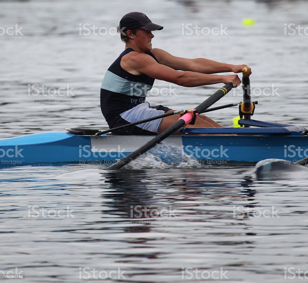 Young Male rower working hard while racing royalty-free stock photo