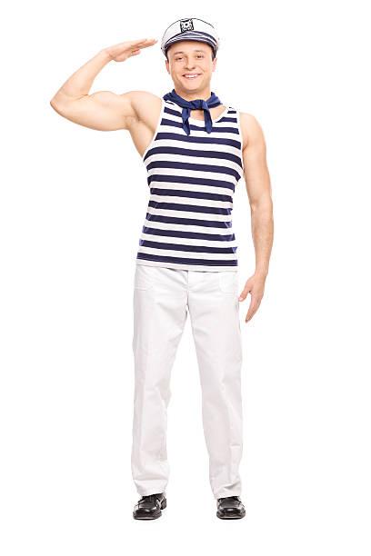 junge männliche sailor gerader stand, und salutieren - matrosin kostüm stock-fotos und bilder