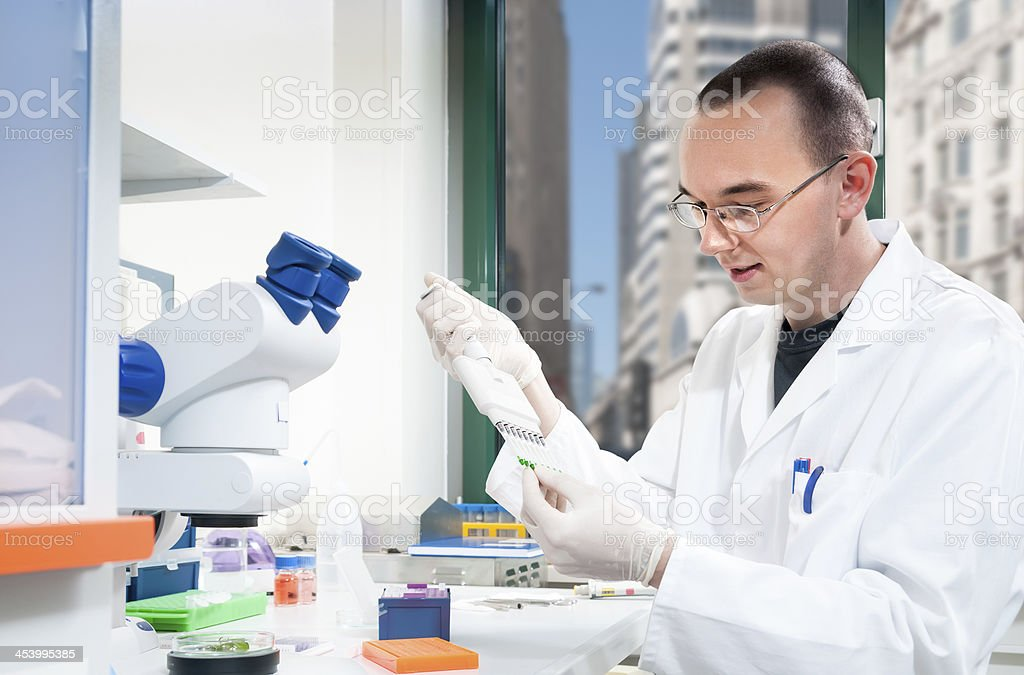 Young male scientist in laboratory stock photo