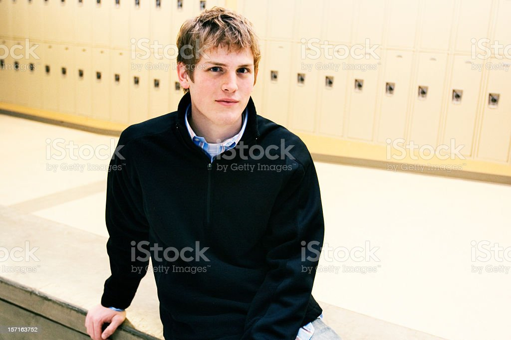 Young Male Sitting in a High School royalty-free stock photo