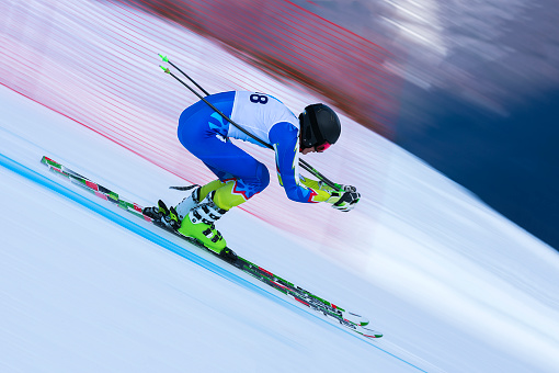 Young Male Skier at Straight Downhill Race