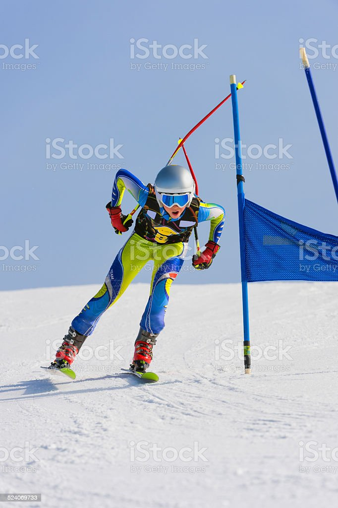Young Male Skier at Straight Downhill Race stock photo