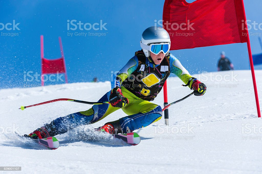 Young Male Skier Passing the Red Gate, Giant Slalom Race stock photo