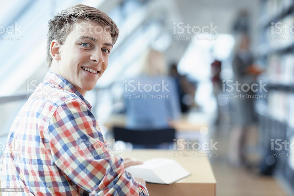 young male student in library stock photo