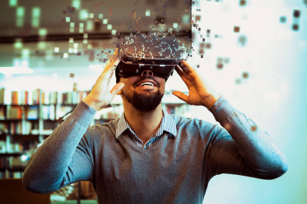 Young male student using Vr Headset stock photo