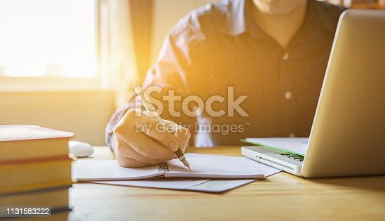 istock Young male student writes information from portable net-book while prepare for lectures in University campus,hipster man working on laptop computer while sitting in cafe,vintage color,selective focus 1131583222