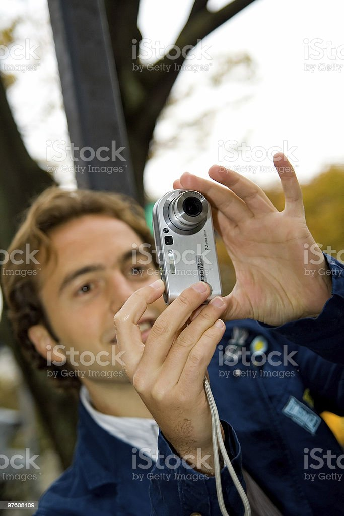 Young male taking pictures-snapshots royalty-free stock photo