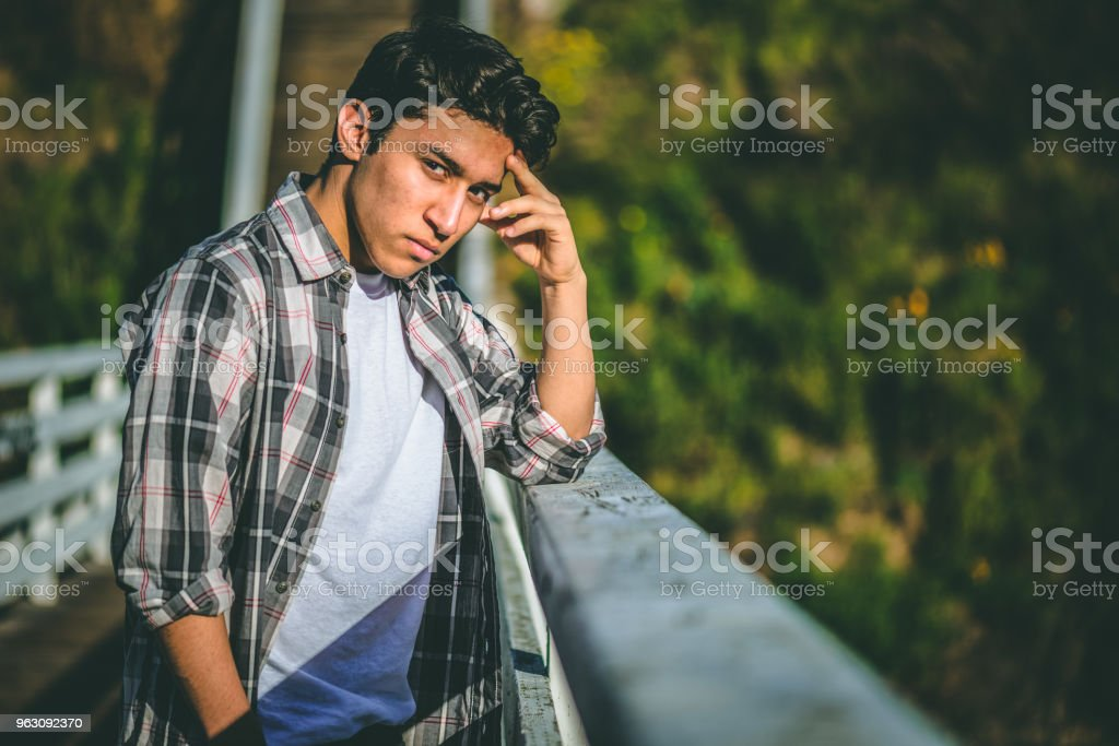 Young male teenager with depression contemplating suicide stock photo