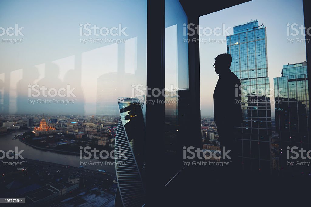 Young male thoughtful rest after briefing stock photo