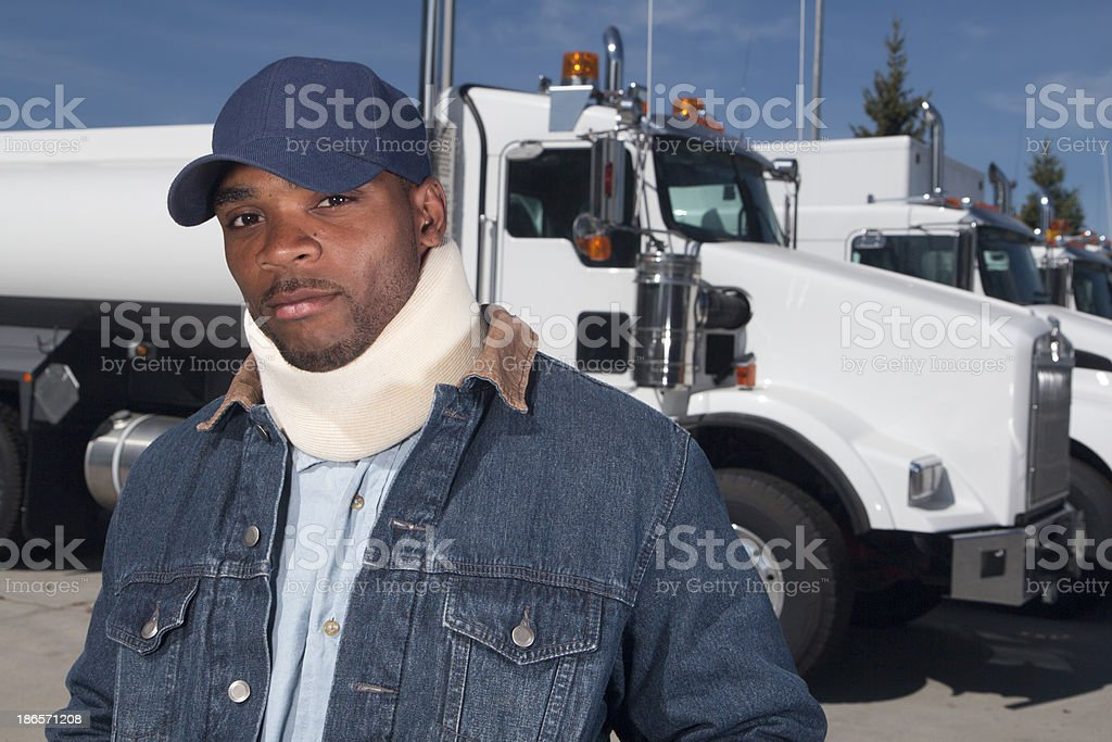 Young male truck driver with a neck injury royalty-free stock photo