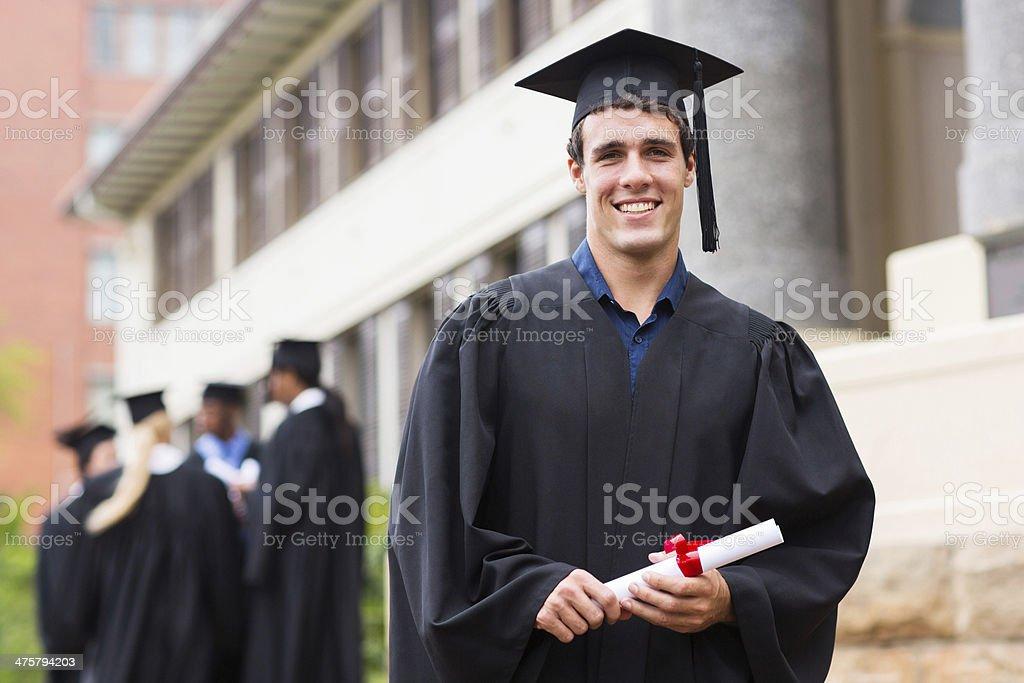 young male university graduate stock photo