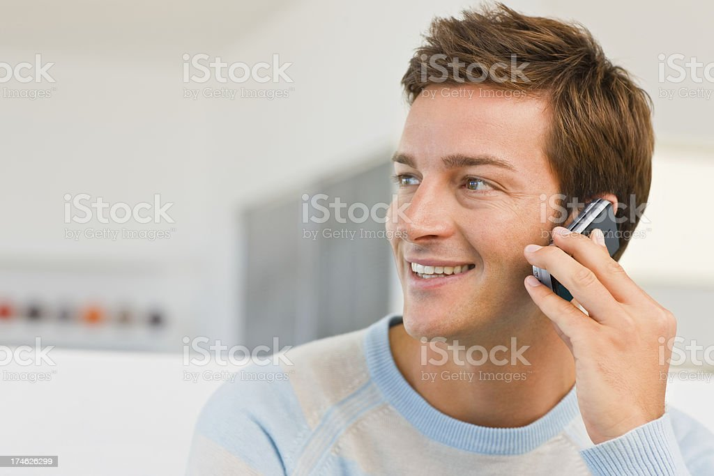 Young male using cellphone looking away royalty-free stock photo