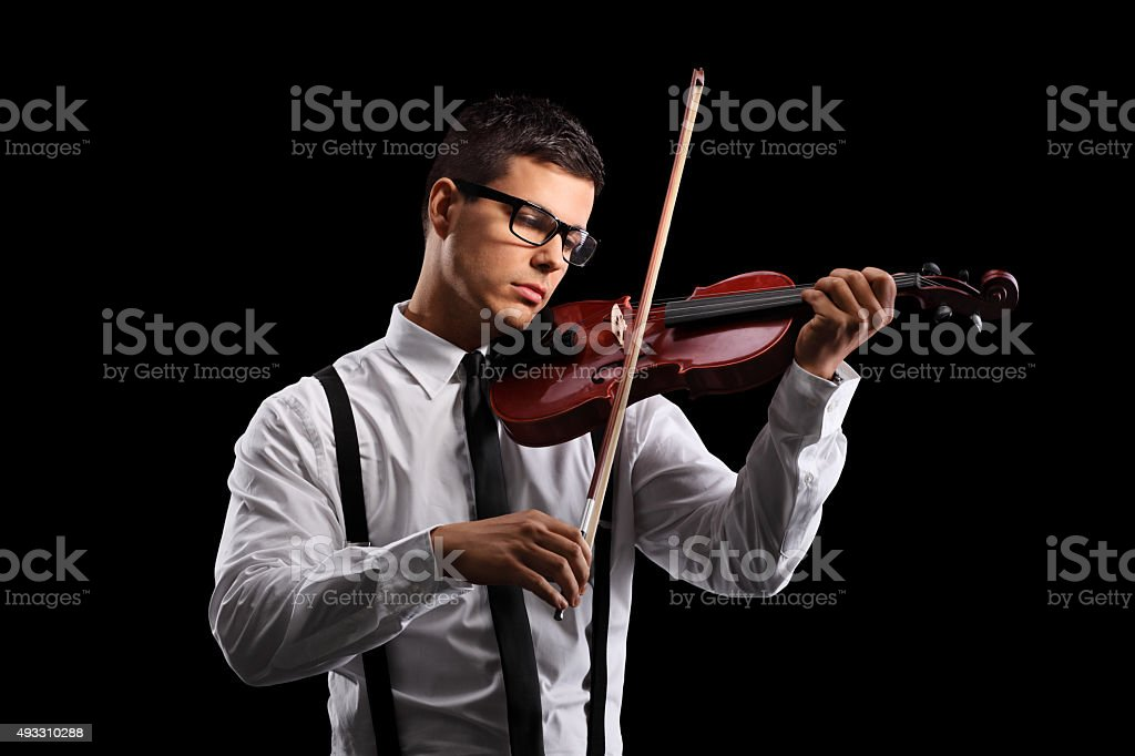 Young male violinist playing an acoustic violin stock photo