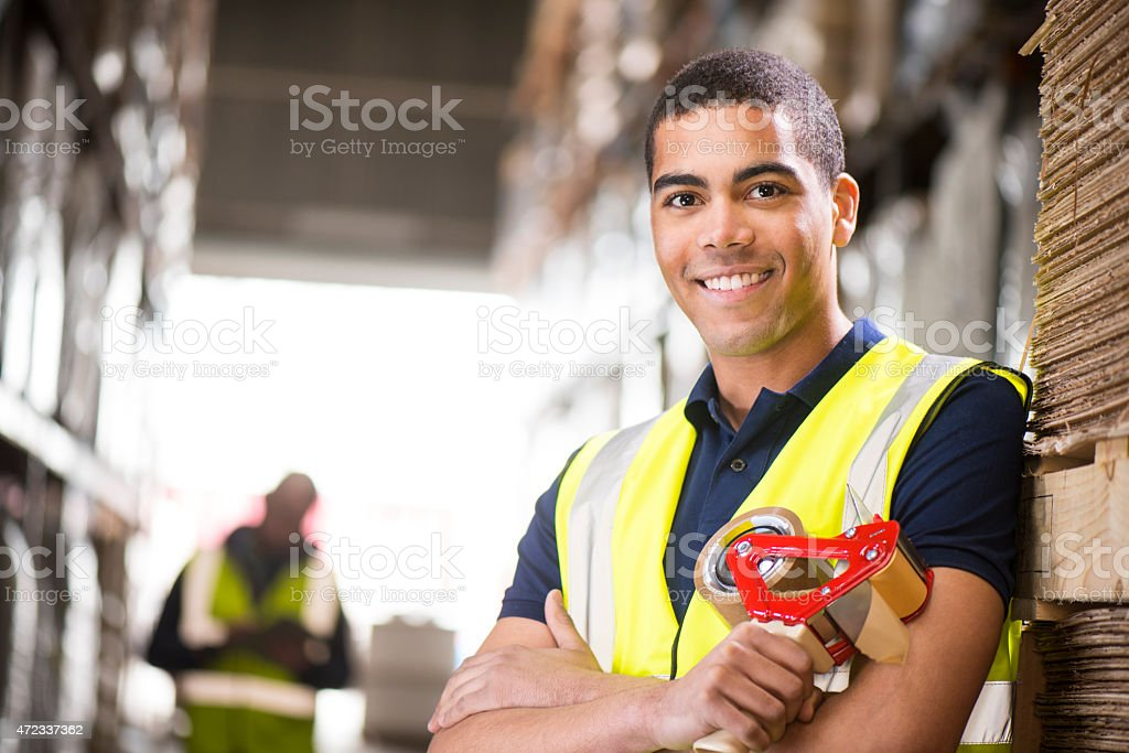 young male warehouse worker portrait stock photo