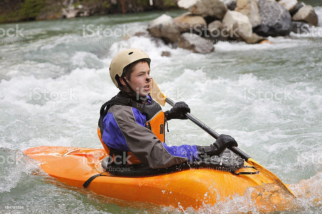 Young Male White Water Kayaking royalty-free stock photo
