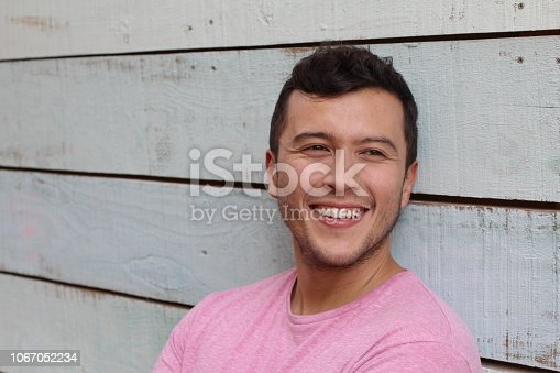 689644378istockphoto Young male with a perfect smile 1067052234