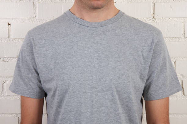 Young male with blank gray t-shirt stock photo