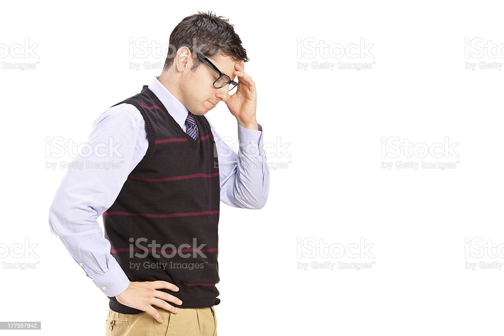 Young male with head down thinking stock photo