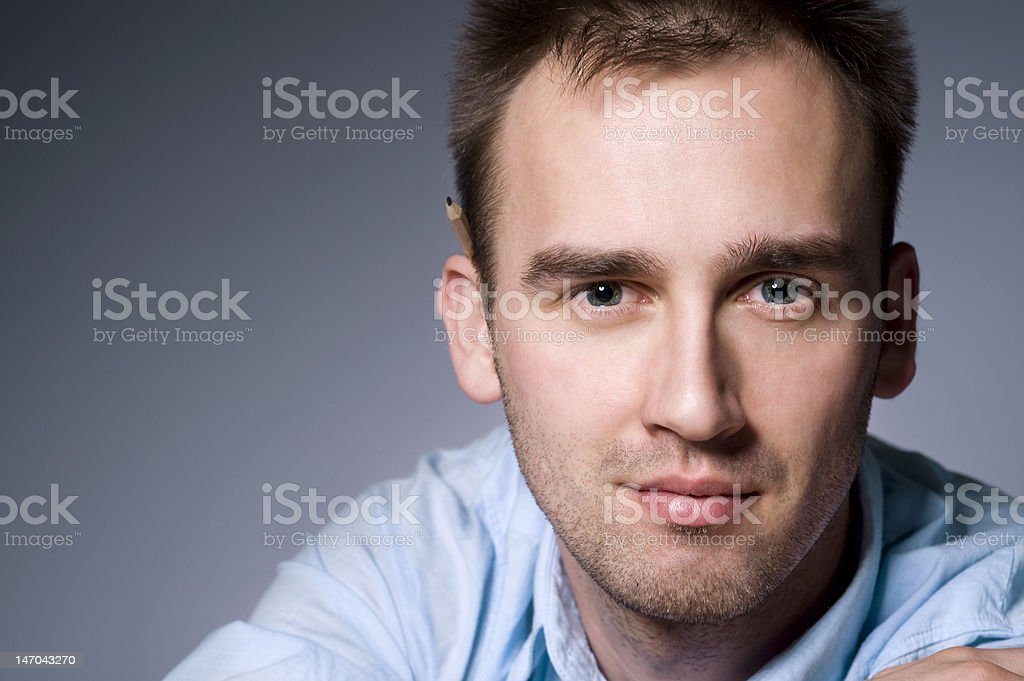 young male with pencil stock photo