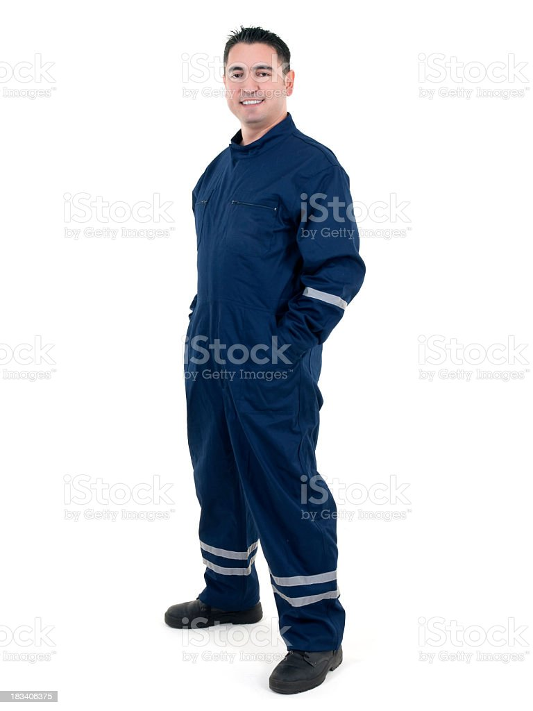 Young male worker in blue uniform against white background stock photo