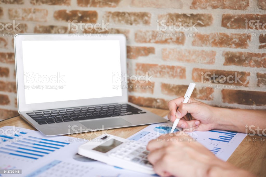 Young male working analysis finance with calculate about cost on investment, planning data on document, business strategy and accounting concept stock photo