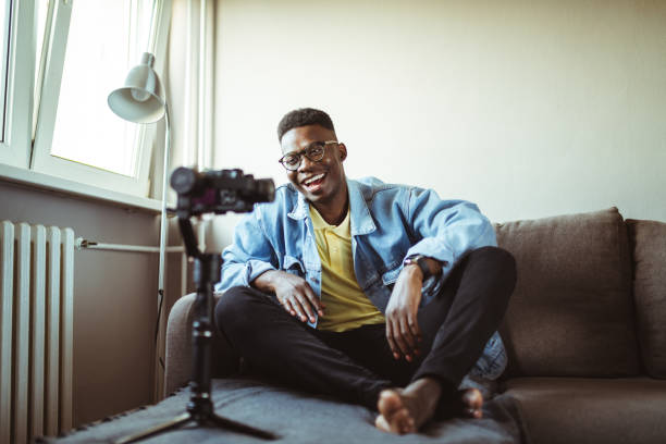 young male youtuber. - side hustle stock pictures, royalty-free photos & images