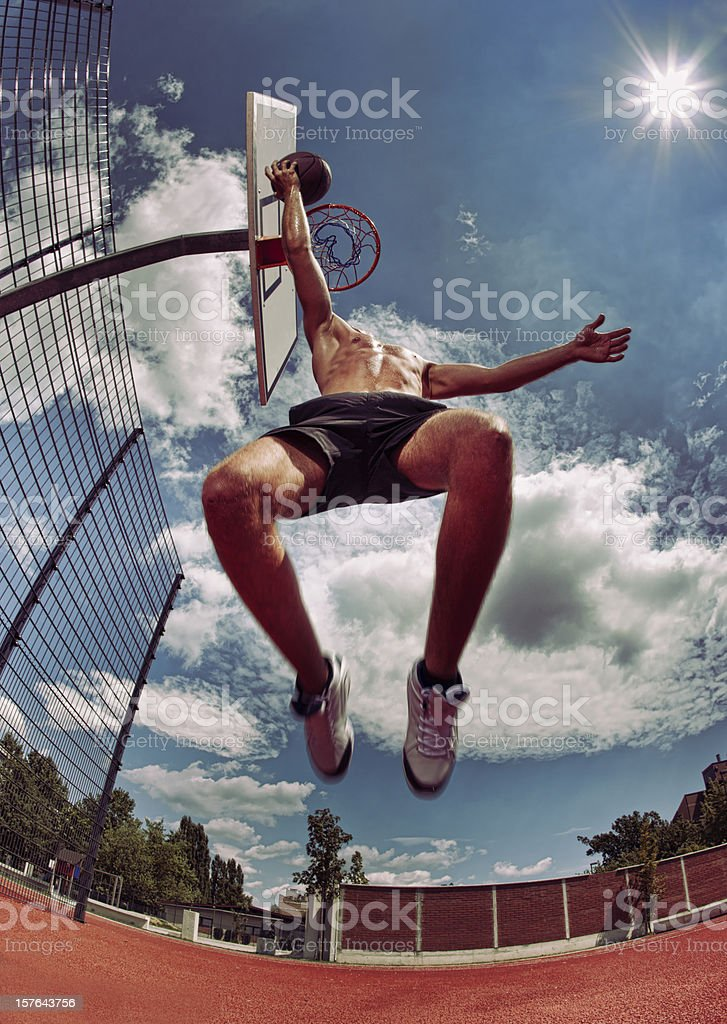 Young man about to slam dunk royalty-free stock photo
