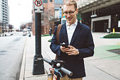 business commuter about to use a shared electric scooter