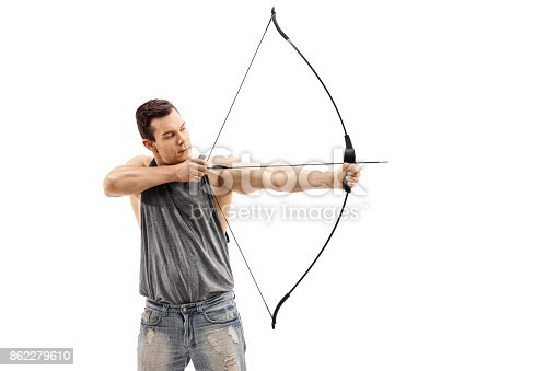 istock Young man aiming with a bow and arrow 862279610