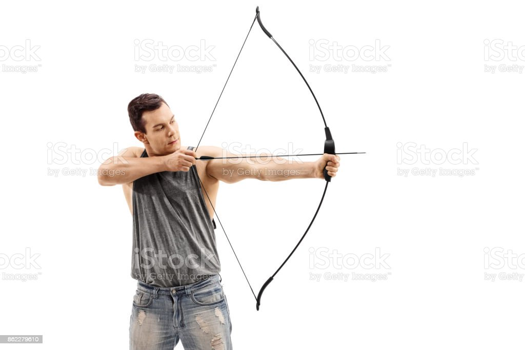Young man aiming with a bow and arrow stock photo