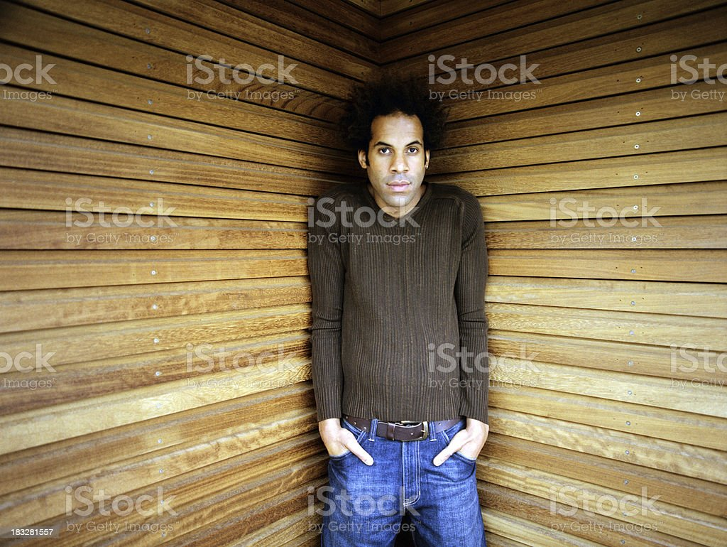 Young man alone in a corner. royalty-free stock photo