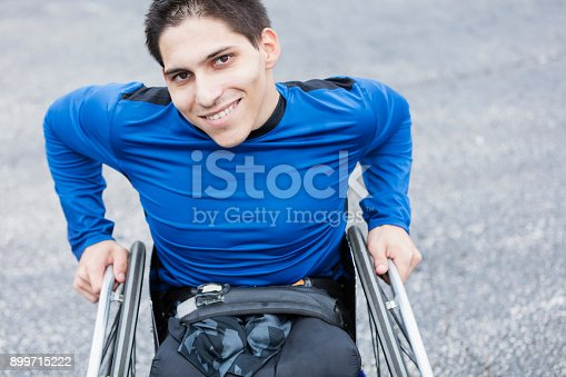 istock Young man, amputee in wheelchair, smiling at camera 899715222