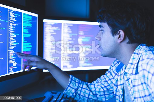 957759714 istock photo Young Man Analyzing the Complex Computer Algorithm 1093461000