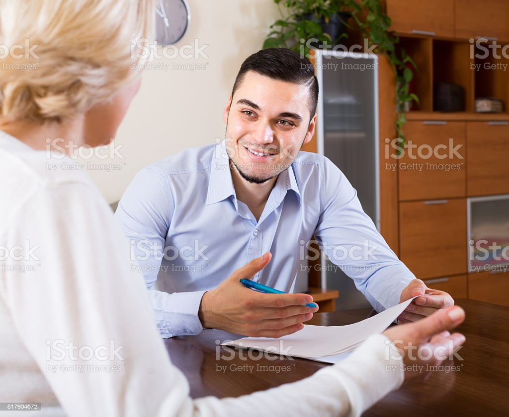 Young man and aged woman with documents stock photo