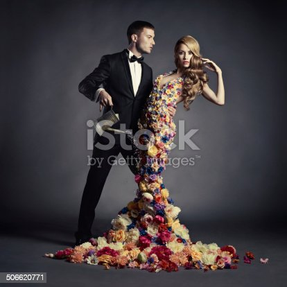 istock Young man and beautiful lady in flower dress 506620771