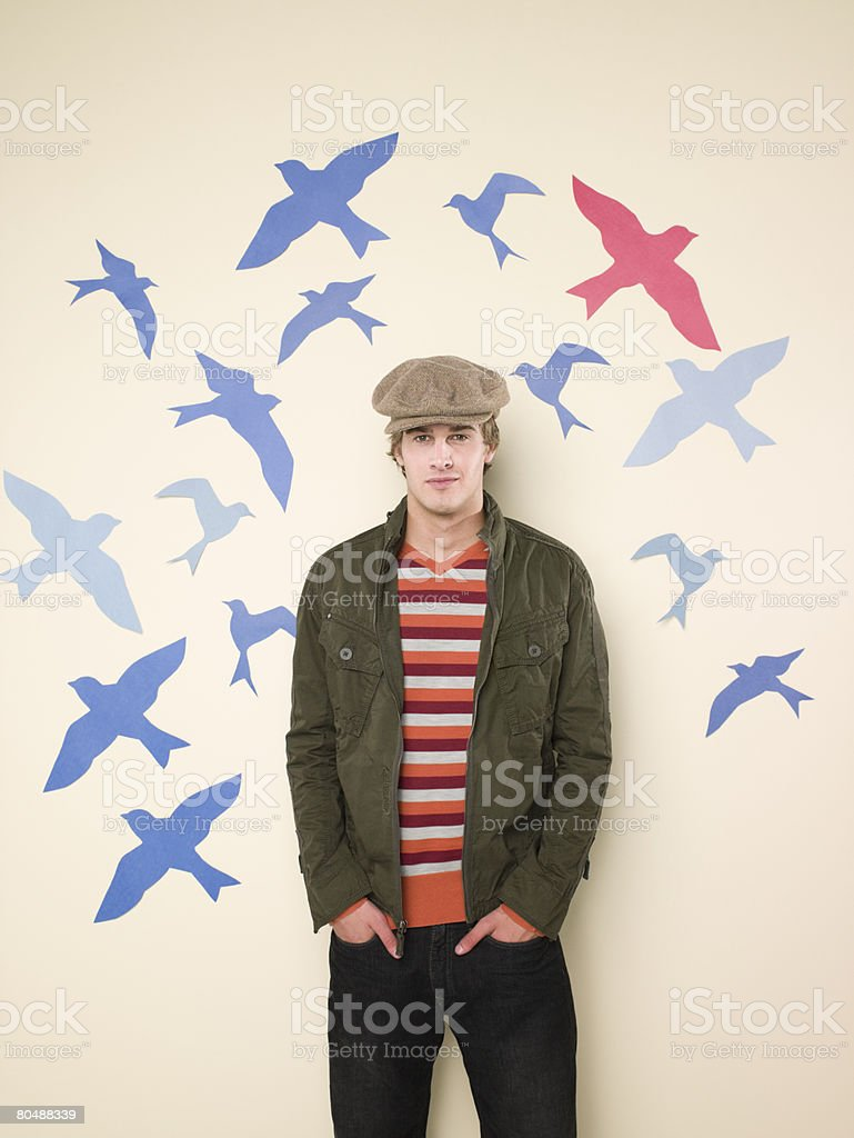 Young man and birds royalty-free stock photo