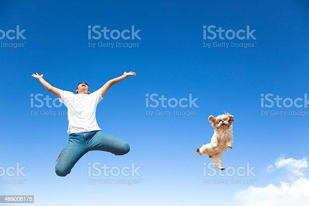Young man and dog jumping in the sky picture id469008175?b=1&k=6&m=469008175&s=612x612&h=lsvh791zrs99zqvamw8sdjia7cwe8fsfgvpeunbqbie=
