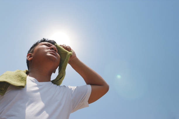 Young man and heat stroke. stock photo