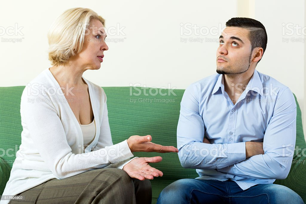 Young man and mature girlfriend stock photo