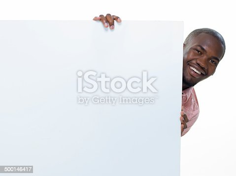 875677322istockphoto Young Man and Placard 500146417