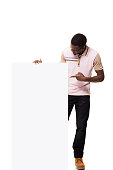 istock Young Man and Placard 835845358