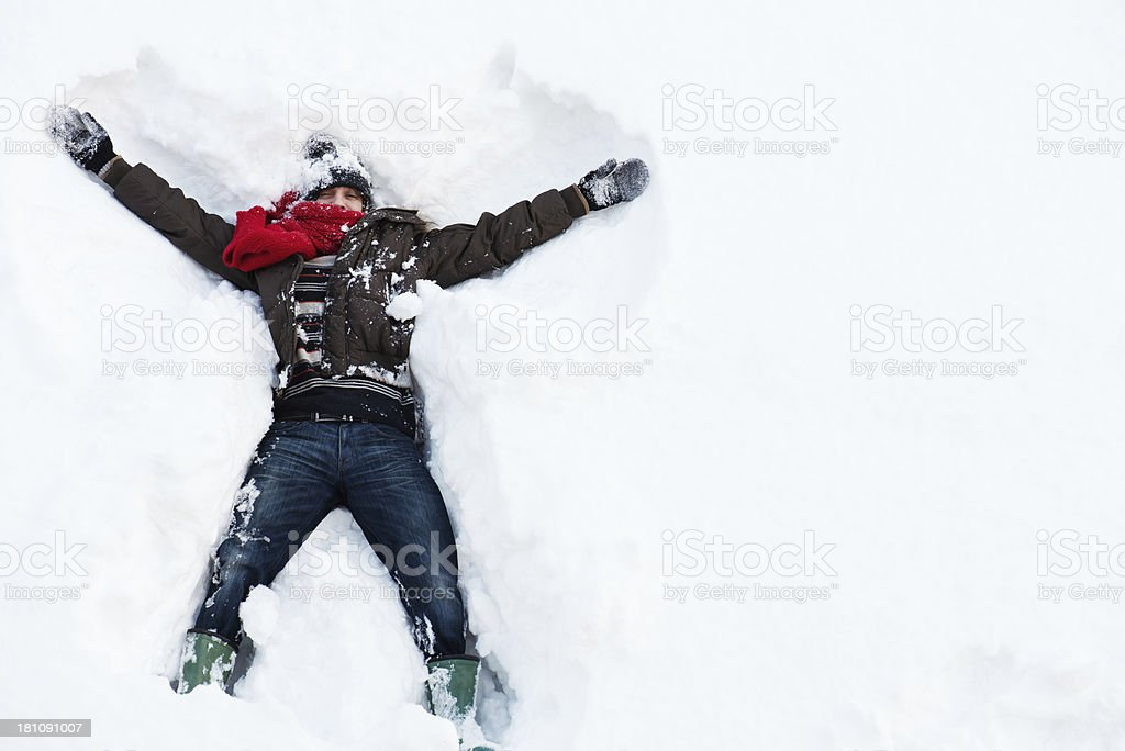 Young man and snow stock photo