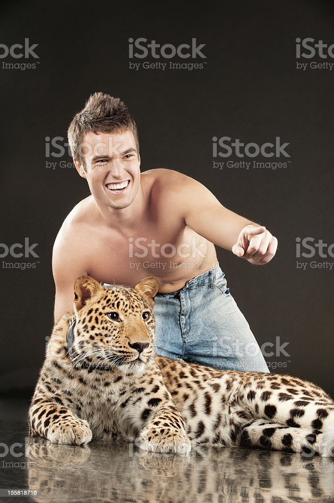 Young man and spotty leopard royalty-free stock photo