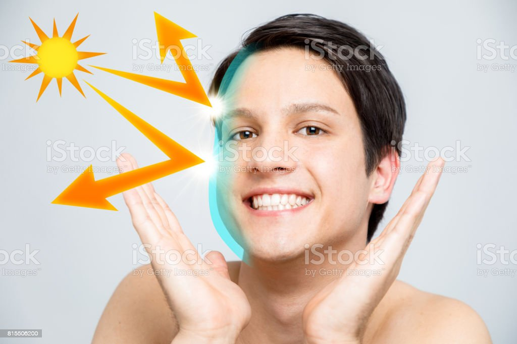 young man and sunscreen, UV protection. stock photo