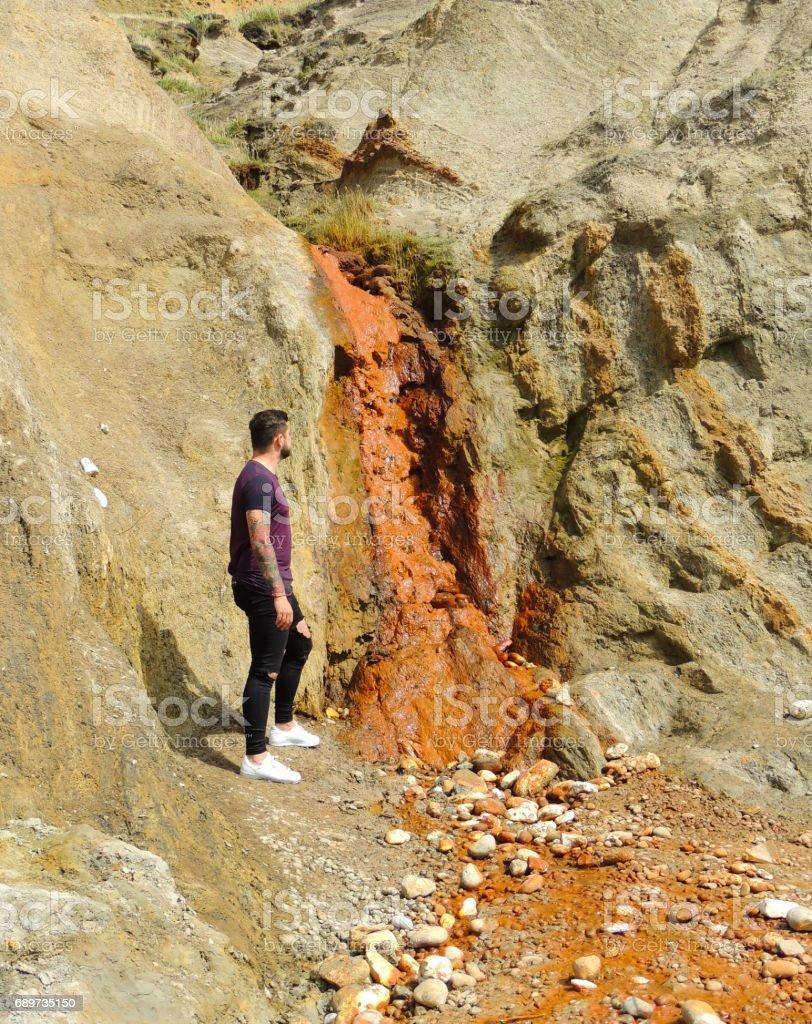 Young Man and Waterfall at Alum Bay stock photo