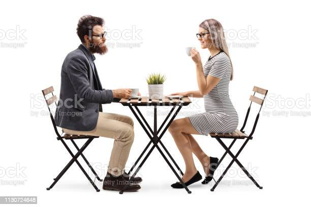Young man and woman drinking coffee at a table picture id1130724648?b=1&k=6&m=1130724648&s=612x612&h=vi3zdog5wia7xhtpifhuterkf3bk674z8878pn7lkos=