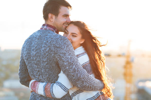 young man and woman embrace and having fun outdoors - falling in love stock pictures, royalty-free photos & images