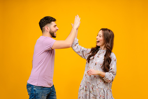 istock Young man and woman isolated over bright yellow background 1161749256